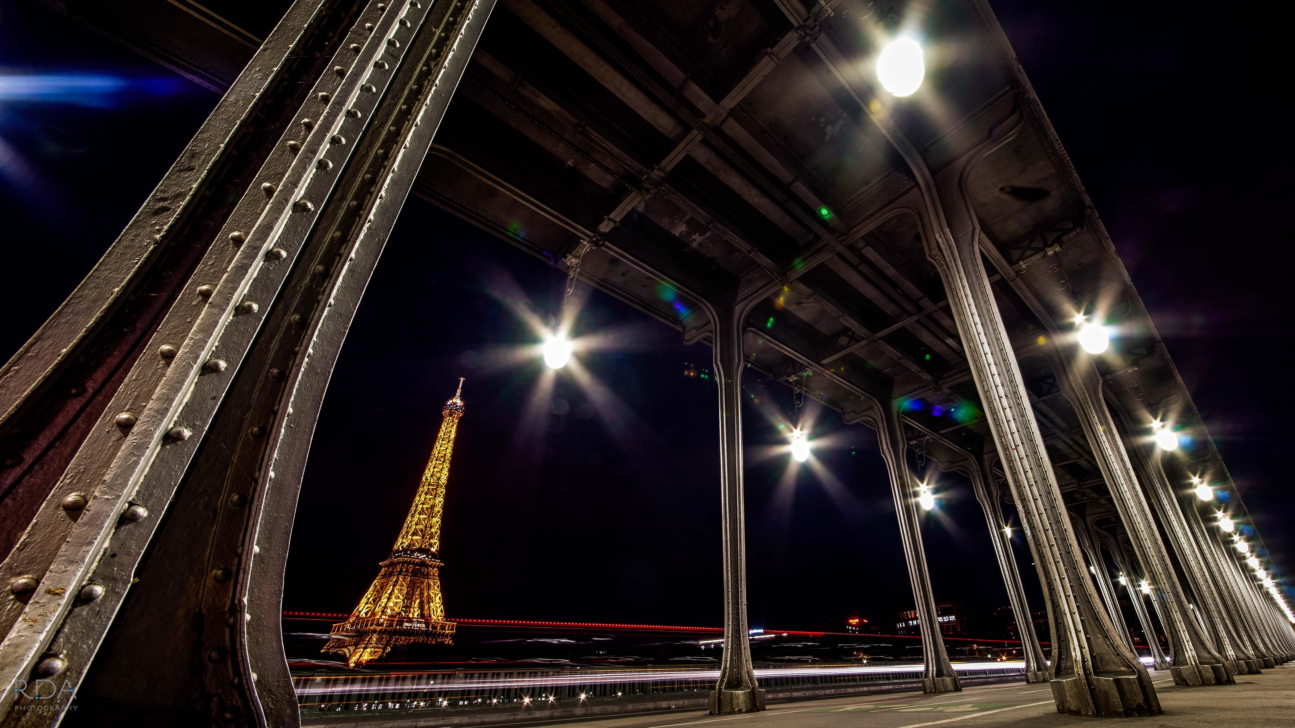 Eiffel Tower at night under bridge