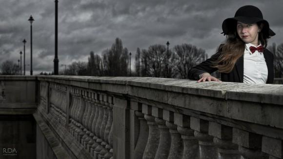 model looking over chiswick bridge